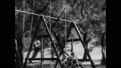 Soldier falling off swinging pole during basic training Stock Footage
