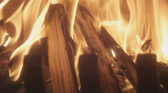 Closeup of fireplace with burning wood shot in slow motion handheld camera ti Stock Footage