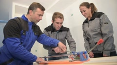 teacher with young people using ceramic saw - stock footage