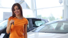Girl selling car at car sales center (NTSC) - stock footage