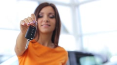 Girl selling car at car sales center (PAL) - stock footage