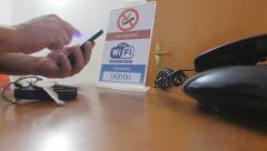 man logging wifi internet connection hotel room - stock footage
