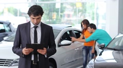 A guy selling the car at car sales center (NTSC) Stock Footage
