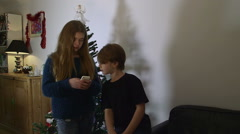 Cute Kids on Smart Phone by Christmas Tree Stock Footage