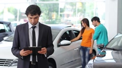 a guy selling the car at car sales center (PAL) - stock footage