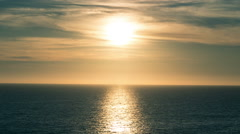 Sun Reflecting off Pretty Ocean Waves with Beautiful Clouds in Sky Sunset Stock Footage