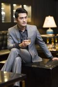 Young businessman in deep thought - stock photo