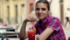 Portrait of beautiful woman drinking cocktail in cafe in city HD Stock Footage
