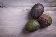 Avocado on a table Stock Photos