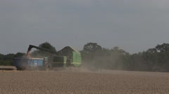 Combine harvester offloading its grain Stock Footage