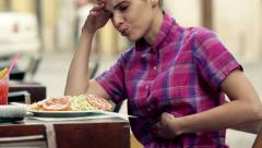 Young woman gets stomach ache during lunch in cafe HD Stock Footage