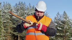 Lumberjack check the sharpness of the ax - stock footage