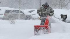 Man Pushing Snowblower in Blizzard Stock Footage