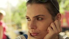 Beautiful, pensive woman looking around and waiting for someone in city HD Stock Footage