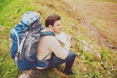 Man with backpack hiking Stock Photos