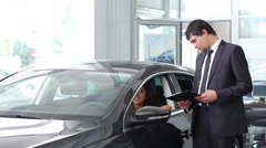 A guy selling the car at car sales center (PAL) Stock Footage