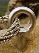 Climbers way. Iron twisted rope fixed in block by screws snap hooks. - stock photo