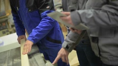 carpentry teacher giving instructions to students - stock footage