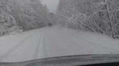 Stock Video Footage of Car pursuit on wintry snowing road, winter driving on rural route