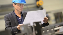 entrepreneur in manufacture checking on materials - stock footage