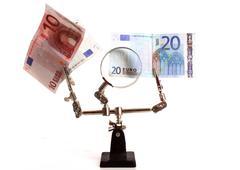 The euro is under fire and thoroughly investigated Stock Photos