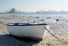 fishermans boat on waterfront in bahrain - stock photo