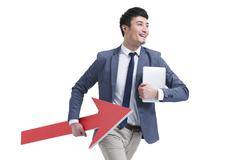 Fashionable businessman with red arrow sign Stock Photos