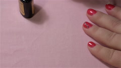 Finishing nail on the hand with clear varnish Stock Footage