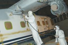 spraying the fuselage - stock photo