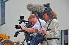 Cameraman at work Stock Photos