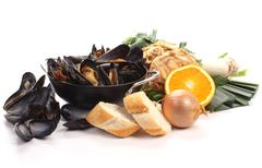 ingredients for preparing a meal of blue mussels - stock photo