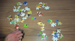 "Collect picture ""Wine The Pooh"" 60 puzzles on the floor. Quick Shot. 50 FPS Stock Footage"