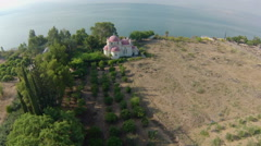 Aerial view of the The Greek Orthodox Church on the sea of galilee, Israel Stock Footage