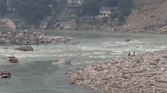 Indian people rafting in a river, Ganges River, Rishikesh, Uttarakhand, India Stock Footage