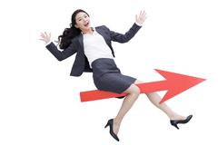 Businesswoman with red arrow sign - stock photo