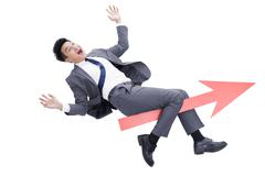 Businessman with red arrow sign Stock Photos