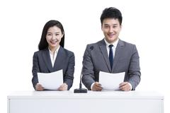 Stock Photo of Business partners broadcasting