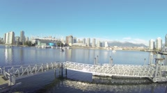 Great day aerial - floating from olympic village to BC place Stock Footage