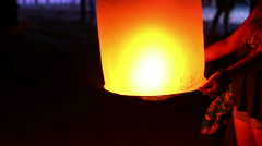 HD footage, Close up woman holds glowing yellow hot chinese lantern Stock Footage
