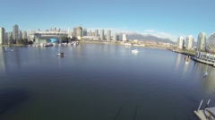Great day aerial over boats and birds towards BC place Stock Footage