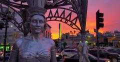 "Silver ""Four Ladies of Hollywood"" gazebo on Hollywood Walk of Fame at sunset. Stock Footage"