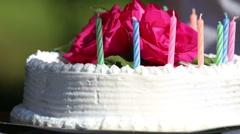 hand turn cake with candle and flower - stock footage