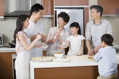 Happy family making dumplings Stock Photos