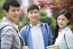 Happy college students on campus Stock Photos