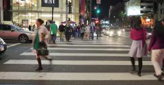 POV walk across crowded Hollywood and Highland Blvd intersection at night 4K UHD Stock Footage