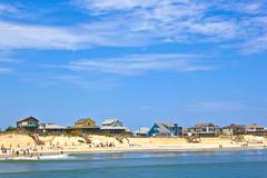 Stock Photo of beach with cottages at nags head in the outer banks