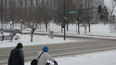 Tilting up to the Capitol Building from snowy streets Stock Footage