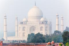 Stock Photo of view of taj mahal in misty morning, india