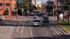 4K UHD establishment shot downtown main one way street facing traffic zoom ou Stock Footage
