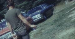 Man Walking Backyard Old Cars 70s 16mm Stock Footage